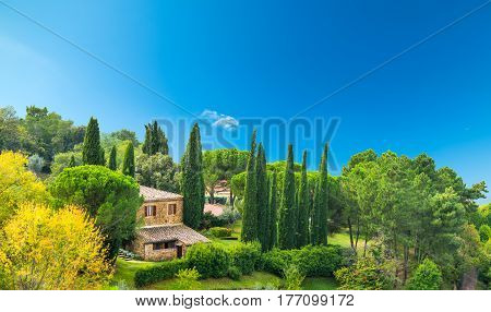 Farmhouse on a green hill in Tuscany Italy