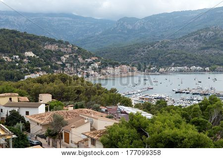 Port with yachts in the bay in the mountains