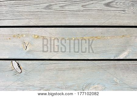 Faded light blue painted threadbare wooden plank