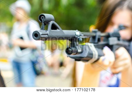sniper Girl looking to the sight air rifle outdoors