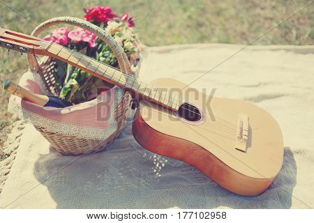 Romantic Photo Guitar, Basket With Wine, Bouquet Flowers On Plaid. Romance, Love, Date, Valentines D