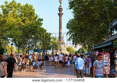 Barcelona, Spain - August 6, 2014: La Rambla street is very popular with tourists and locals.