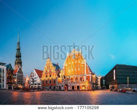 Riga, Latvia - July 1, 2016: Scenic Panoramic View Of Town Hall Square, Popular Showplace With Famous Landmarks On It In Bright Evening Illumination In Summer Twilight Under Blue Sky.