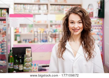 Pharmacist Woman In Front Of Her Desk At Work