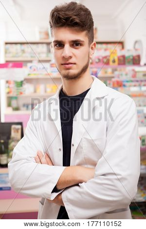 Doctor In Front Of His Desk At Work