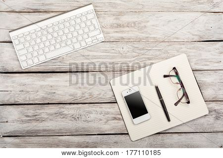 Working Place View From Above: Keyboard, Book, Mobile Phone, Glasses