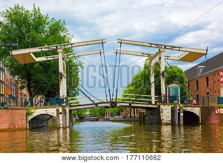 View the Popular Drawbridge Bascule on a canal in the city of Amsterdam capital of Netherlands. Horizontal Image
