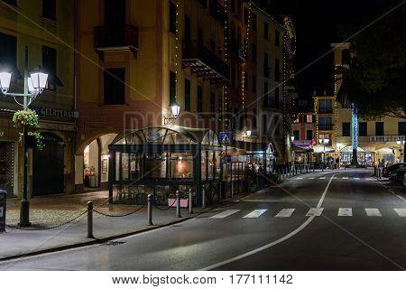 SANTA MARGHERITA LIGURE, ITALY - DECEMBER 2016: Night street with restaurants at Santa Margherita town, Italy
