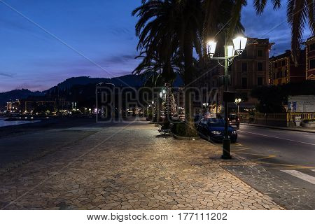SANTA MARGHERITA LIGURE, ITALY - DECEMBER 2016: Night street near coastline ofSanta Margherita town, Italy