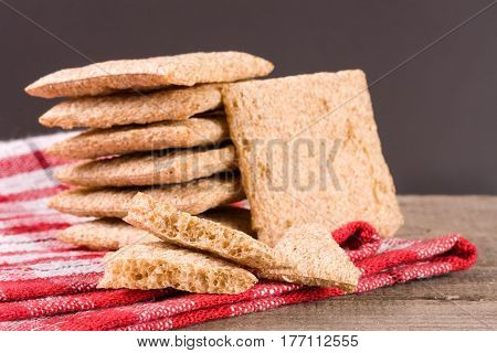 stacked crisp bread on a wooden table.