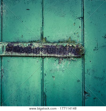Grungy Rusty Hinge On A Rustic Green Wooden Door