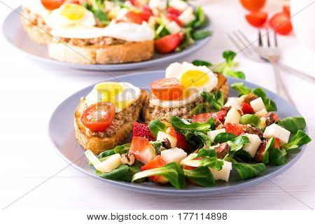 Salad With Strawberry, Spinach And Goat Cheese.  Bruschettes