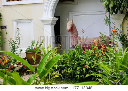 Plants, flowerpots, flowerbed the largest and papier-mache horse. Buddhist temple in South East Asia: Kek Lok Si Malaysia