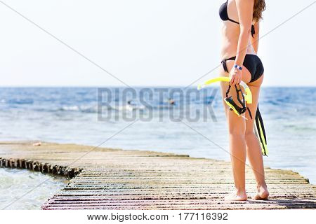 Young woman standing with equipment for snorkeling. Copy space image snorkel background