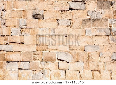 old stone wall made with big blocks light brown color beautiful texture and big size photo
