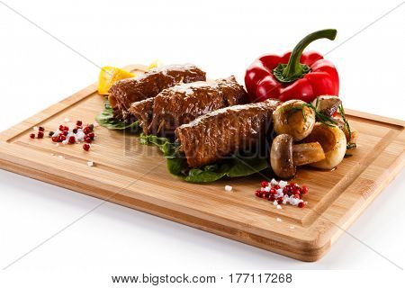 Wrapped pork chops served on cutting board