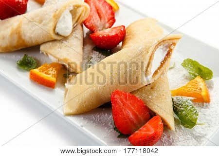 Crepes with strawberries and creme