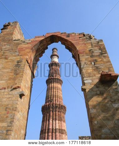 Iconic image of the Qutub Minar monument in New Delhi India is the tallest brick minaret tower in the world.