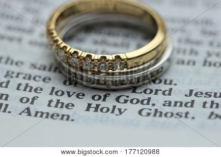 Two diamond wedding bands for a double bride wedding on a bible verse