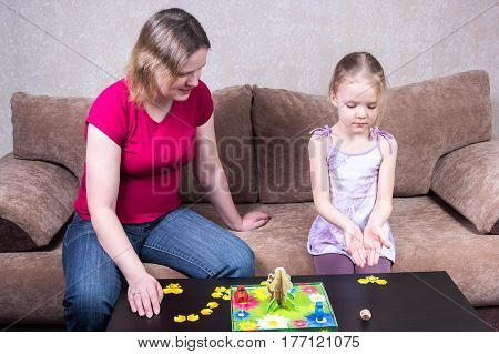 Mom And Daughter Playing Table Game