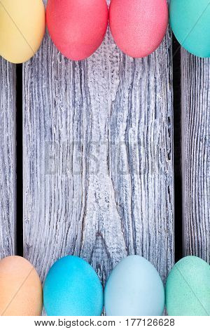 Dyed eggs on wooden backdrop. Colorful Easter eggs.