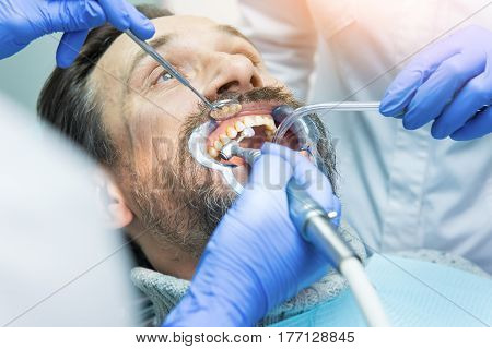 Male patient at the stomatologist. Teeth of mature man.