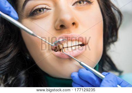 Work of a dentist. Examination of teeth. Medicine saves smiles.