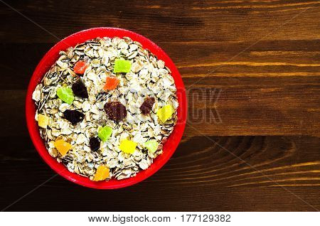 Oatmeal   With  Dried Fruit (strawberries, Grapes, Kiwi, Peach). Oatmeal On A Wooden Table. Oatmeal