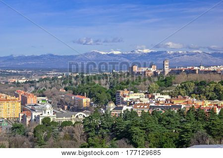 Aerial view of Madrid with Guadarrama Mountains (Sierra de Guadarrama) on background Spain