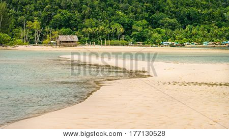 Sandy Bank in front of Local Village on Monsuar Island. Raja Ampat, Indonesia. West Papua