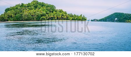 Friwen Island in Front and Friwen Wall in Background, West Papuan, Raja Ampat, Indonesia.