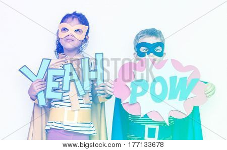 Sister and brother holding papercraft yeah and pow word