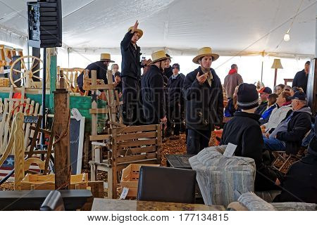 PENRYN PENNSYLVANIA - MARCH 18 2017: Amish volunteers sell furniture and crafts at the annual auction