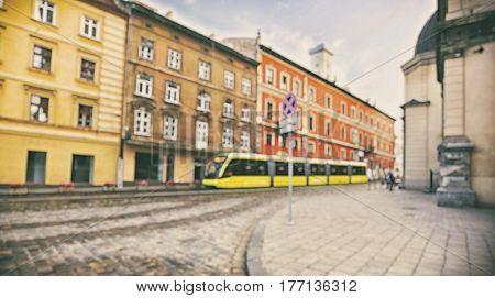 Lviv's old street with yellow orange tram, Ukraine