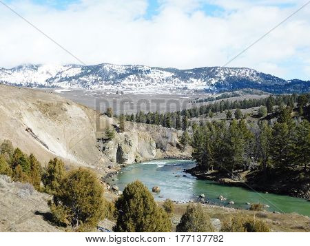 Yellowstone National Park View of river and snow covered mountains