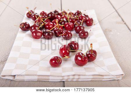 Fresh washed cherries on wooden underground