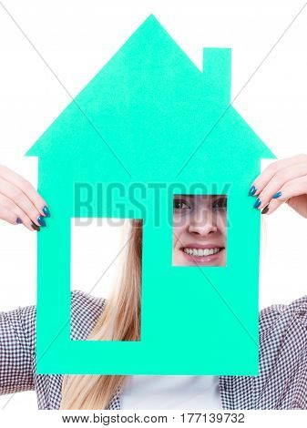 Ownership and property concept. Happy woman holding blue paper house moving to new home.