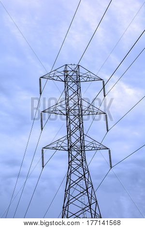 High voltage tower for electric under blue cloudy sky