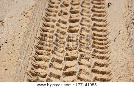 Wheel track in the sand texture. Coast beach sand surface car wheel track on the sand in the natural environment.