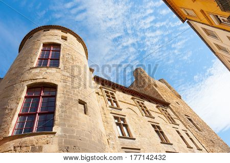 Urban scenes sky above converging buildings traditional architecture low angle point of view Narbonne France.
