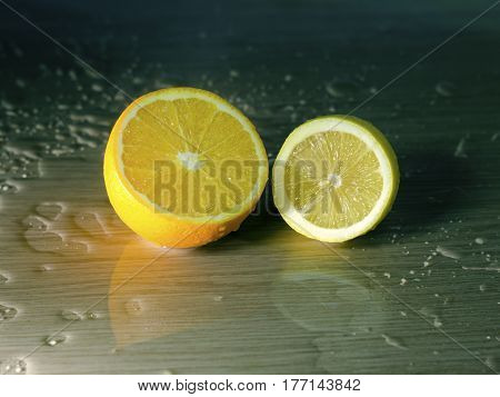Half an orange and the lemon and the water drops