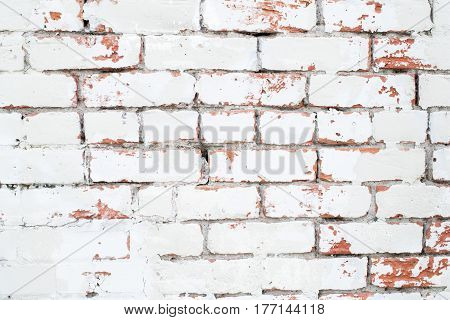 Vintage background: old red and white brick wall. Old white brick wall with textured background. whitewashed grunge brick wall with red and white vintage background.