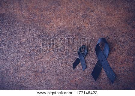 Black Ribbons On Dark Toning Background For Skin Cancer Awareness, Melanoma Awareness,narcolepsy Awa