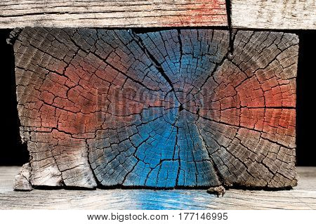 Painted wooden block texture red and blue. Part of a wooden pallet, this block showcases weathered wood textures and unorthodox coloring.