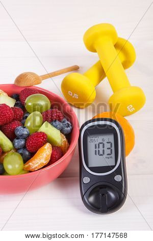 Fresh Fruit Salad, Glucometer And Dumbbells, Diabetes, Healthy Lifestyle And Nutrition Concept