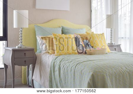 Classic Style Bedside Table With Reading Lamp Next To Cozy Style Bedding With Many Style Of Green An