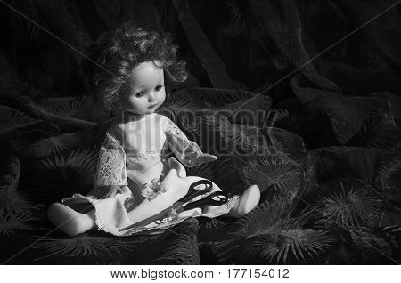 Old not necessary doll with scissors .