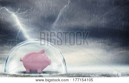 Piggybank safely inside a sphere during a storm . Protect gains from the crisis