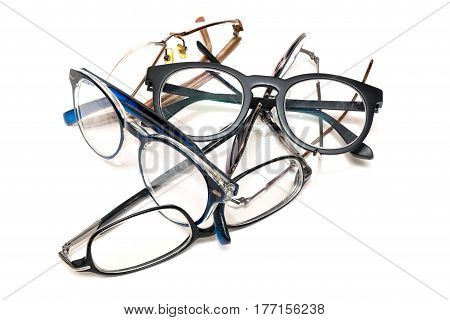 group of unused old eyeglasses from male and female on isolated white background.