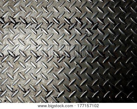 An image of a seamless diamond metal plate texture